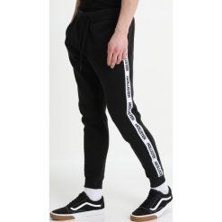 Spodnie męskie: Hollister Co. PRINT LOGO SKINNY JOGGER Spodnie treningowe black