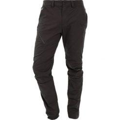 Spodnie sportowe damskie: Dynafit Spodnie materiałowe asphalt