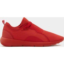 Buty męskie: Czerwone buty sportowe z gumką