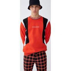 Spodnie chinosy tailoring w szkocką kratę. Czarne chinosy męskie Pull&Bear. Za 139,00 zł.