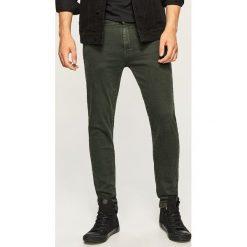 Jeansy slim fit - Zielony. Zielone jeansy męskie relaxed fit marki QUECHUA, m, z elastanu. Za 129,99 zł.
