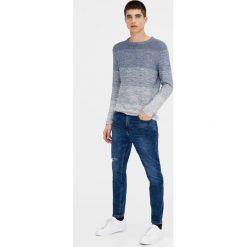 Jeansy męskie regular: Ciemnoniebieskie jeansy carrot fit