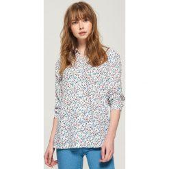 Wzorzysta koszula - Niebieski. Niebieskie koszule wiązane damskie Sinsay, l. Za 39,99 zł.