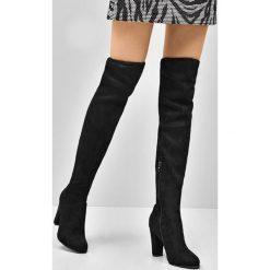 Czarne Kozaki Sincere. Czarne buty zimowe damskie Born2be, z materiału, z okrągłym noskiem, na wysokim obcasie, na obcasie. Za 129,99 zł.