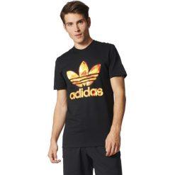 Adidas Originals Koszulka męska TRF Graphic T 3 czarna r. M (BQ3130). Białe t-shirty męskie marki Adidas, l, z jersey, do piłki nożnej. Za 115,39 zł.