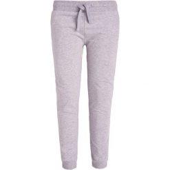 Spodnie dresowe dziewczęce: Spodnie dresowe dla dziewczynki 9-13 lat