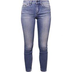 DRYKORN NEED Jeans Skinny Fit mid blue denim. Niebieskie rurki damskie DRYKORN. W wyprzedaży za 503,20 zł.