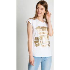 Bawełniana bluzka ze złotą aplikacją BIALCON. Żółte bluzki nietoperze BIALCON, s, z aplikacjami, z bawełny, sportowe. Za 119,00 zł.