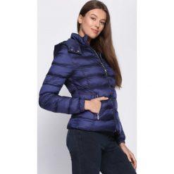 Ciemnoniebieska Kurtka Clearly. Brązowe kurtki damskie pikowane marki QUECHUA, na zimę, m, z materiału. Za 119,99 zł.