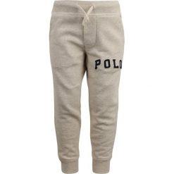 Polo Ralph Lauren BOTTOMS PANT Spodnie treningowe new sand heather. Brązowe spodnie chłopięce marki Reserved, l, z kapturem. Za 249,00 zł.