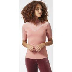 Koszulka adidas Velvet High Neck Tee (CV9440). Różowe bralety marki Adidas, z elastanu, z krótkim rękawem. Za 77,99 zł.