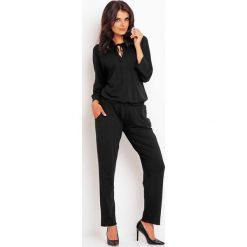 Odzież damska: Elegancki Czarny Kombinezon z Koronkową Wstawką na Plecach