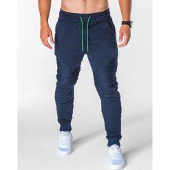 SPODNIE MĘSKIE DRESOWE P644 - GRANATOWE. Niebieskie spodnie dresowe męskie marki Ombre Clothing, z bawełny. Za 55,00 zł.