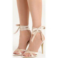 Beżowe Sandały Choosy. Brązowe sandały damskie marki Born2be, z materiału, na wysokim obcasie, na obcasie. Za 69,99 zł.