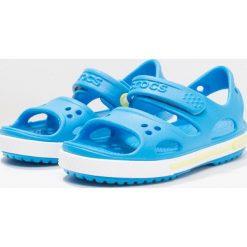 Crocs CROCBAND II  Sandały kąpielowe ocean/tennis ball green. Niebieskie sandały chłopięce marki Crocs, z gumy. Za 129,00 zł.