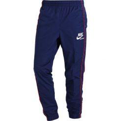 Spodnie dresowe męskie: Nike Sportswear ARCHIVE Spodnie treningowe binary blue/university red/summit white