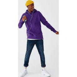 Bluza basic z kieszenią kangurką. Czerwone bluzy męskie rozpinane marki KALENJI, m, z elastanu, z długim rękawem, długie. Za 79,90 zł.