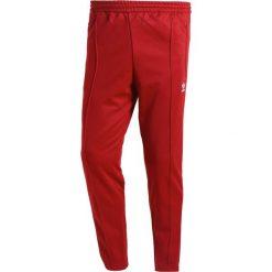 Spodnie dresowe męskie: adidas Originals ADICOLOR BECKENBAUER  Spodnie treningowe rust red