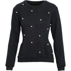 Czarna Bluza One Pearl. Czarne bluzy sportowe damskie marki DOMYOS, z elastanu. Za 44,99 zł.