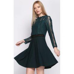 Ciemnozielona Sukienka Emotionless. Zielone sukienki mini marki Reserved, z wiskozy. Za 79,99 zł.