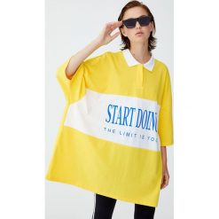 Koszulka sportowa. Żółte bluzki sportowe damskie Pull&Bear, z krótkim rękawem. Za 55,90 zł.