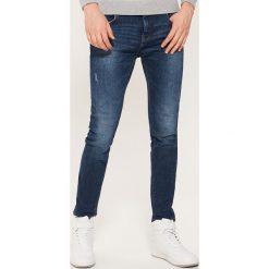 Jeansy slim - Niebieski. Niebieskie jeansy męskie slim marki House. Za 99,99 zł.