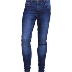 Cheap Monday HIM SPRAY Jeans Skinny Fit dim blue. Niebieskie rurki męskie Cheap Monday. W wyprzedaży za 146,30 zł.