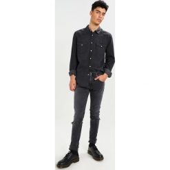 Tiger of Sweden Jeans Jeans Skinny Fit black. Niebieskie jeansy męskie relaxed fit marki Tiger of Sweden Jeans. Za 629,00 zł.