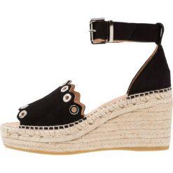 Kanna CAPRI Sandały na platformie black. Czarne sandały damskie Kanna, z materiału, na koturnie. Za 509,00 zł.
