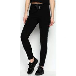 Spodnie dresowe damskie: Czarne Spodnie Dresowe Conveniently