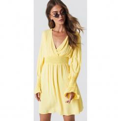 Trendyol Sukienka z marszczoną talią - Yellow. Szare sukienki z falbanami marki Trendyol, na co dzień, z elastanu, casualowe, midi, dopasowane. Za 60,95 zł.
