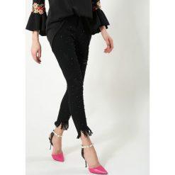 Czarne Jeansy One Step Closer. Zielone jeansy damskie marki other, l, prążkowane. Za 104,99 zł.