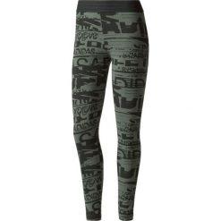 Spodnie sportowe damskie: Adidas Spodnie damskie Sport ID Allover Print czarno-zielone r. XS (BQ9427)