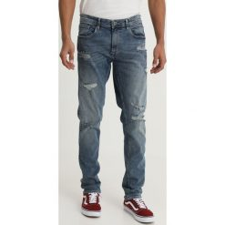 Blend JET Jeansy Slim Fit denim middle blue. Brązowe jeansy męskie marki Blend, l, z bawełny, bez kaptura. Za 209,00 zł.