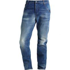 GStar ARC 3D TAPERED Jeansy Zwężane fleck denim. Czerwone jeansy męskie marki G-Star, l, z napisami. W wyprzedaży za 365,40 zł.