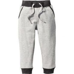 Spodnie dresowe bonprix jasnoszary melanż - antracytowy melanż. Czarne spodnie dresowe chłopięce marki bonprix, z nadrukiem. Za 29,99 zł.