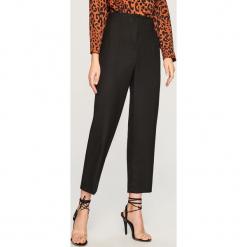 Spodnie z wysokim stanem - Czarny. Czarne spodnie z wysokim stanem marki House, z jeansu, z podwyższonym stanem. Za 139,99 zł.