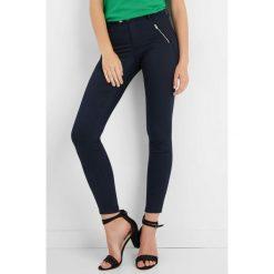 Spodnie skinny z zamkami. Brązowe rurki damskie marki Orsay, s, z dzianiny. Za 129,99 zł.
