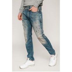 G-Star Raw - Jeansy D-Staq. Niebieskie jeansy męskie slim marki G-Star RAW. W wyprzedaży za 499,90 zł.