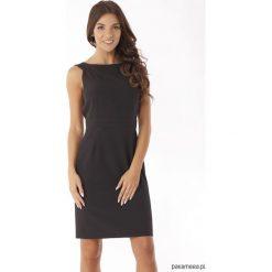 1192d9531c Dopasowana sukienka odcięta w pasie czarna. Czarne sukienki damskie  koktajlowe marki Pakamera