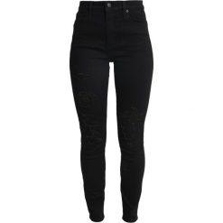 Abercrombie & Fitch SHRED SIMONE  Jeans Skinny Fit black. Czarne jeansy damskie relaxed fit Abercrombie & Fitch, z bawełny. Za 409,00 zł.