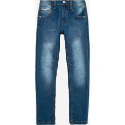 Blukids - Jeansy dziecięce 134-164 cm. Niebieskie jeansy chłopięce Blukids. W wyprzedaży za 39,90 zł.