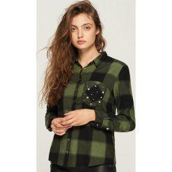 Koszula z aplikacją na kieszeni - Khaki. Brązowe koszule damskie marki DOMYOS, xs, z bawełny. Za 59,99 zł.
