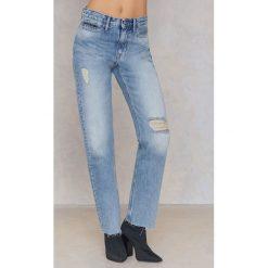 Calvin Klein Proste jeansy 7/8 z wysokim stanem - Blue. Niebieskie proste jeansy damskie marki Calvin Klein, z bawełny. W wyprzedaży za 275,98 zł.