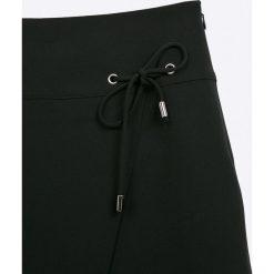 Sly - Spódnica dziecięca 134-164 cm. Czarne spódniczki dziewczęce SLY, z elastanu, mini. Za 99,90 zł.