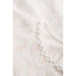 Bluzki asymetryczne: Bluzka z koronki w kwiaty