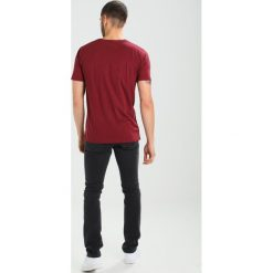 Spodnie męskie: Carhartt WIP REBEL PANT MARGATE Jeansy Slim Fit black stone washed