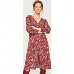 Sukienka midi - Wielobarwn. Różowe sukienki marki Reserved, midi. Za 99,99 zł.