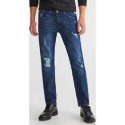 Jeansy z dziurami regular fit - Granatowy. Szare jeansy męskie regular marki Sinsay. Za 129,99 zł.