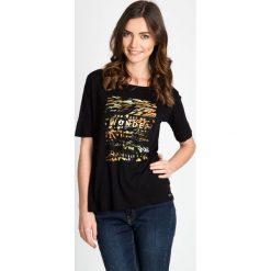 Bluzki asymetryczne: Czarna bluzka ze zwierzęcym motywem QUIOSQUE